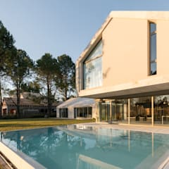Casa CM: Casas unifamiliares de estilo  por Además Arquitectura,Minimalista Mármol