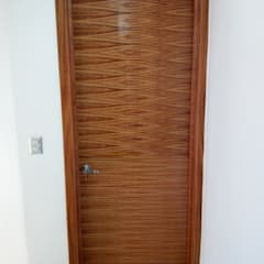 Inside doors by Fabros Carpinteros, Tropical Wood Wood effect