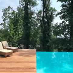 สระว่ายน้ำอินฟินิตี้ by Kirchner Garten & Teich GmbH