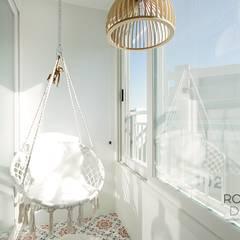 부산 전망 좋은 해운대 아파트 인테리어: 로하디자인의  베란다