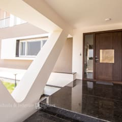 Sree Subham:  Front doors by ARK Architects & Interior Designers