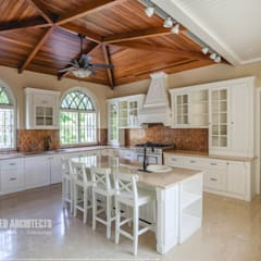 Kitchen by S Squared Architects Pvt Ltd., Colonial Solid Wood Multicolored