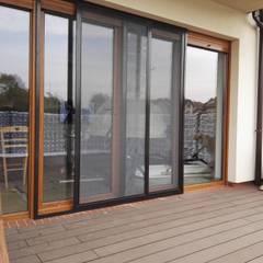 Balcón de estilo  por SPIN Bobko i Staniewski sp.j.