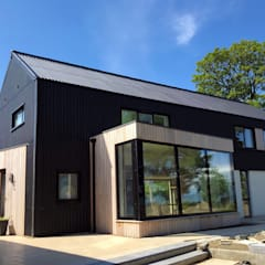 Contemporary Barn House, Derry / Londonderry:  Detached home by Marshall McCann Architects, Modern Wood Wood effect