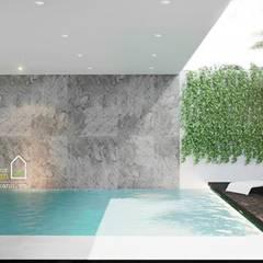 NHÀ PHỐ CAO BẰNG TRÀN NGẬP ÁNH SÁNG :  Hồ bơi by Green Interior,