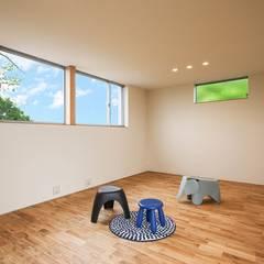 音を包む家: STaD(株式会社鈴木貴博建築設計事務所)が手掛けた子供部屋です。,