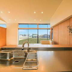 楽土間の家: STaD(株式会社鈴木貴博建築設計事務所)が手掛けたキッチンです。,