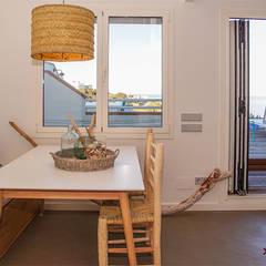 Dining room by Xmas Arquitectura e Interiorismo para reformas y nueva construcción en Barcelona