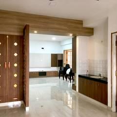 Dr. Kuppuraj Residence @ Coimbatore:  Dining room by Olive Architecture Studio,Minimalist Plywood