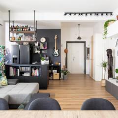 Ristrutturazione appartamento di 100 mq a Roma, Prati Fiscali: Soggiorno in stile  di Facile Ristrutturare