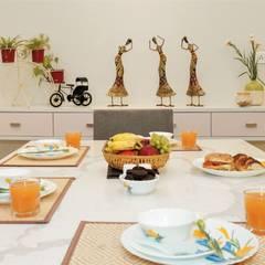 Dining room by DESIGN EVOLUTION LAB,