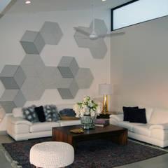 Ejemplos de casas nivel residencial: Salas de estilo  por Rabell Arquitectos,
