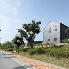 모든색을 품은 따뜻한 블랙, 세종시 고운동 락현재: 주택설계전문 디자인그룹 홈스타일토토의  전원 주택,모던 슬레이트