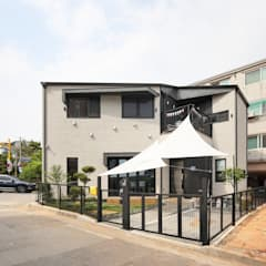 Rumah kayu oleh 주택설계전문 디자인그룹 홈스타일토토, Modern Ubin