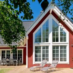 Wooden houses by Skan-Hus Projekt GmbH,