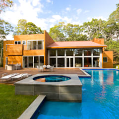 Gil + Gil: Casas multifamiliares de estilo  por GIL+GIL