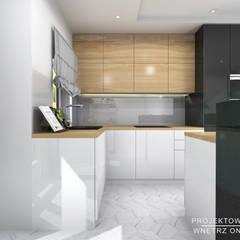 Built-in kitchens by Projektowanie Wnętrz Online,