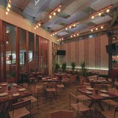 Restaurante Augurio: Restaurantes de estilo  por Iluminamos