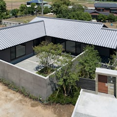 Single family home by Atelier Square, Asian Concrete