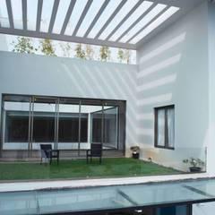 Modern garden by DesignQube Modern