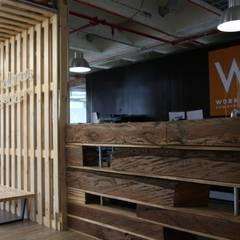 Workolony: Oficinas y Tiendas de estilo  por Gamma,
