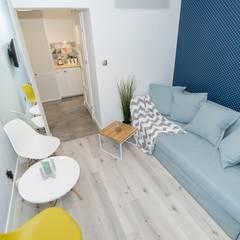 Kawalerka na wynajem w Sopocie: styl , w kategorii Salon zaprojektowany przez Lux Interiors - projektowanie i aranżacja wnętrz Gdańsk, Gdynia, Sopot