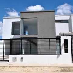 Casa C3TII: Casas unifamiliares de estilo  por Francisco Forero Aponte - Arquitecto,