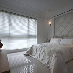 Projekty,  Małe sypialnie zaprojektowane przez 大桓設計顧問有限公司, Klasyczny