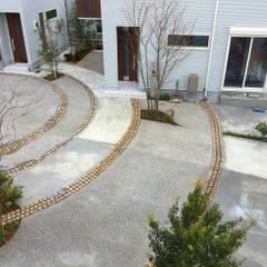 クルドサック風分譲住宅: 結ランドスケープデザインが手掛けたリゾートハウスです。