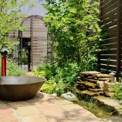 Estanques de jardín de estilo  por 株式会社Garden TIME, Rural Ladrillos