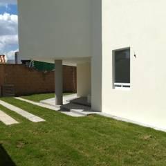 INTERIORES: Villas de estilo  por DINPROC, SC., Moderno