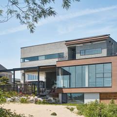 K: 건축사사무소 호반석(주)의  전원 주택,모던