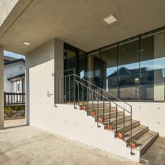 K: 건축사사무소 호반석(주)의  테라스 주택,모던 콘크리트
