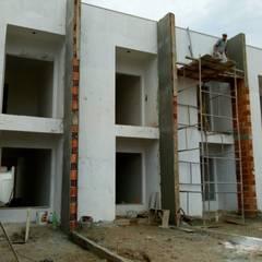 Projeto de casas geminadas - ADEMAR GARCIA por Jr Arquitetura + interiores Moderno