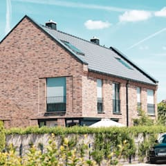منزل عائلي صغير تنفيذ Architekturbüro Krogmann, حداثي حجر