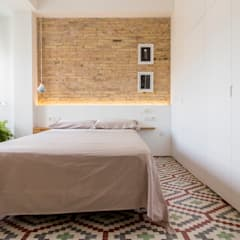 Reforma de vivienda en el Ensanche de Valencia: Dormitorios de estilo  de DonateCaballero Arquitectos, Moderno