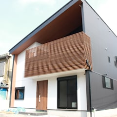 Single family home by (株)西村工務店, Eclectic