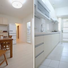 Small kitchens by 大觀創境空間設計事務所, Asian