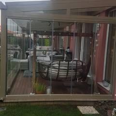 Modern conservatory by Yapısan Cephe Sist.San.ve Tic.Ltd.Şti. Modern Glass