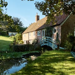 Watermill Restoration :  Country house by Hart Design and Construction ,