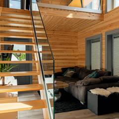 غرفة المعيشة تنفيذ THULE Blockhaus GmbH - Ihr Fertigbausatz für ein Holzhaus
