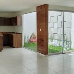 بيت زجاجي تنفيذ EM  Arquitectura,