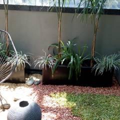 Jardines con piedras de estilo  por VIVERO XOCHIQUETZAL , Ecléctico Piedra