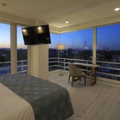 Hotel Velvet Plaza: Hoteles de estilo  por Echauri Morales Arquitectos, Moderno