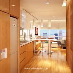 Sahid Sudirman Residence: Dapur built in oleh ADEA Studio, Modern Kayu Lapis