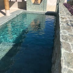 Swimming pond by SUKABUMI STONE MÉXICO, Asian Stone