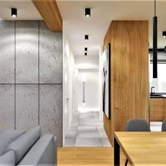 Część dzienna, bliźniak w Toruniu: styl , w kategorii Salon zaprojektowany przez Wkwadrat Architekt Wnętrz Toruń,