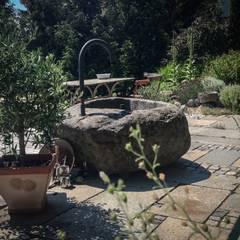 Jardines de piedra de estilo  por Steiner Naturstein,