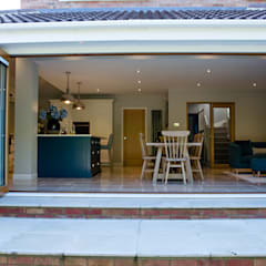 Bordon wraparound extension and reconfiguration project:  Detached home by dwell design, Modern