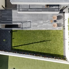 Casa Cidade da Maia: Jardins de fachada  por Raulino Silva Arquitecto Unip. Lda,Minimalista